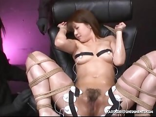 Asian girl tied down for extreme orgasm session with Hitachi magic wand