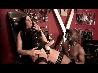 Amazon mistress smokes while she pegs and pisses on small black man