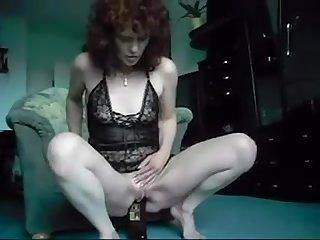 Redhead mature bottle show