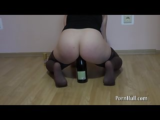 Anal rider on a bottle pushed on an ass on a bottle young brunette