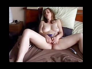 Paula masturbates to orgasm on a bed hidden cam