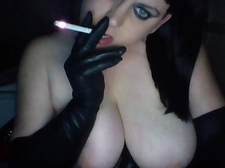 Milf with big tits smoking and talking in gloves and corset