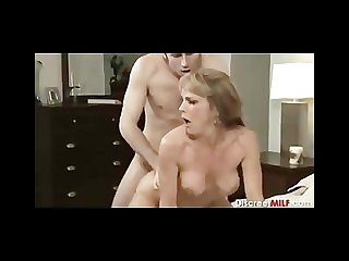 Mature milf with young man in bedroom