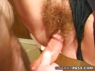Granny gets her hairy pussy stuffed in the kitchen