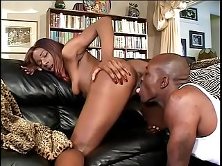 Black bitch Ms. Cocoa in heels gets her cunt fucked with a fat dick on the couch