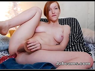 SExy beautiful redhead chick fucking herself on cam at Jabcams.com