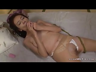 Mature woman in pantyhose masturbating fingering herself using vibrator on the m