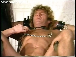 Slave tied to a chair got clamps and needles trough his nipples en finger fucked in the ass