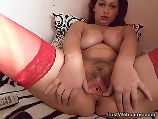 Busty MILF plays with her hairy pussy on cam
